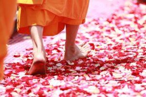 buddhist walking on flowers